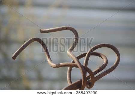 Old Rusty Armature, Figuratively Curved Into An Interesting Figure