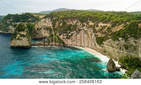 Aerial view of the Korawa beach bay and rocky coastline in the Nusa Penida island, near Bali, Indonesia