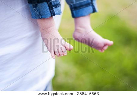 Adorable Tiny Feet Of A Newborn Baby Boy Girl Child. Father Holds An Infant On His Hands Stock Image