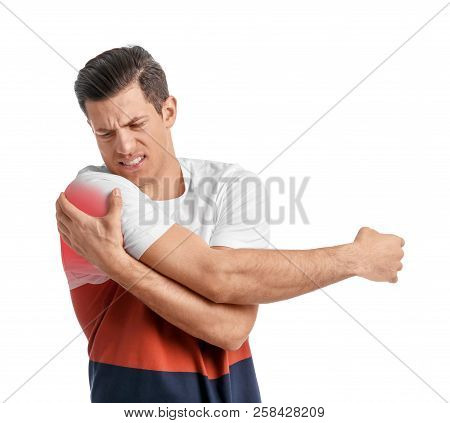 Young Man Suffering From Shoulder Pain On White Background
