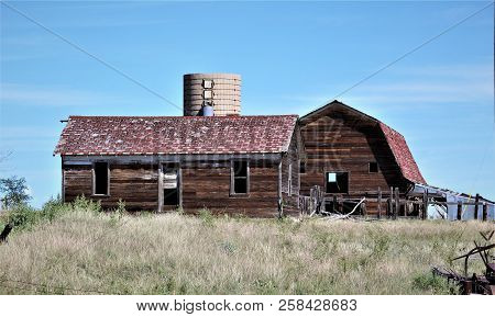 A Weathered Barn Stands Near The Back Of This Abandoned Farm On The Colorado Plains.