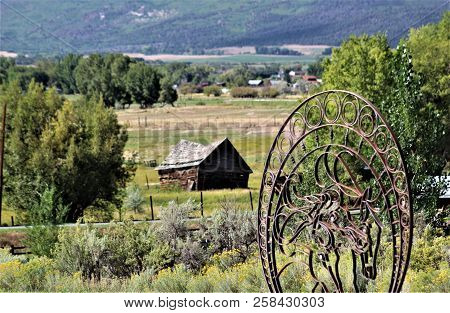 A Unique Grave Marker In A Quiet Cemetery Overlooks This Slowly Collapsing Barn In The Colorado Moun