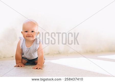 Baby Girl Have Fun, Playing And Crawling On A City Street Of Europe. Little Child Outdoors In A Town