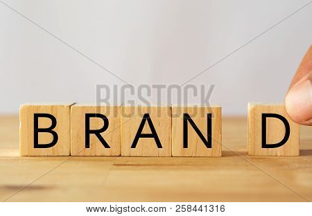 Hand Man Try To Complete The Brand Word On Wooden Cube, Brand Concept