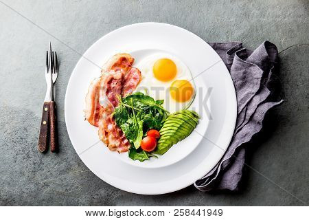 Ketogenic diet breakfast. fried egg, bacon and avocado, spinach and bulletproof coffee. Low carb high fat breakfast poster