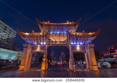 The Gate Of Yunnan Nationalities Village And Many People Are Visiting  At  Kunming City, Yunnan Prov