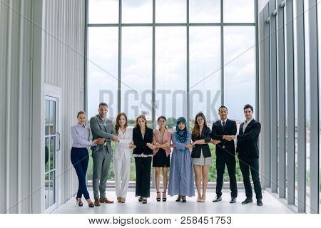 Colleagues With Holding Hands Standing In Office .business People Team Hold Hands Together Side By S