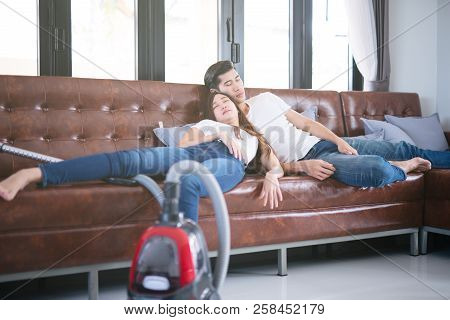 Man Husband Cleaning The House Helping Wife And Cleaning Lady Taking A Nap On Sofa After Cleaning Th