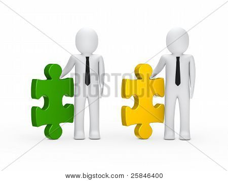 Businessmen Hold Puzzle