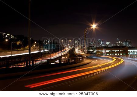 Seattle Night Scene With Light Trails From Passing Cars On I5 And Overpass
