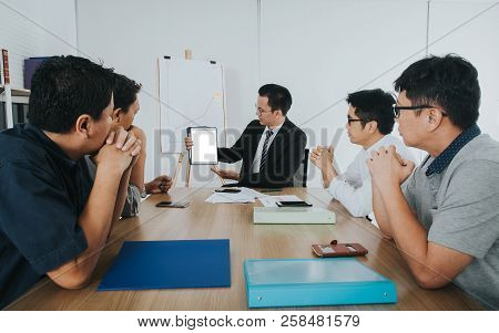 Asian Businessman Using Touchpad Discussing At Meeting Room.