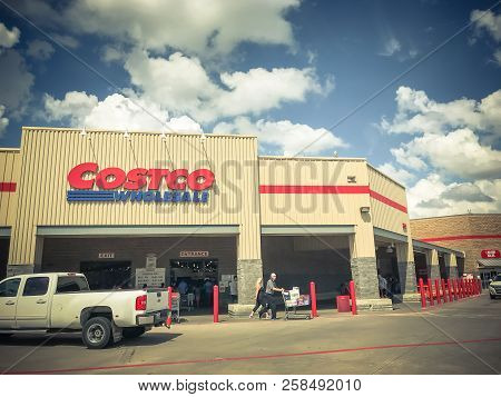 Filtered Tone Truck Driving By Busy Costco Wholesale Store With Customer Leaving
