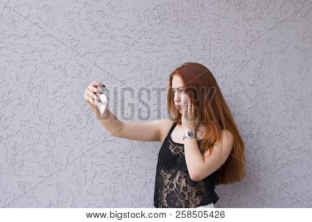 Waist-up Portrait Of Young Good-looking Model Taking Selfie Wearing Nice Lace Shirt And Standing On