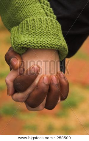Male & Female Clasping Hands