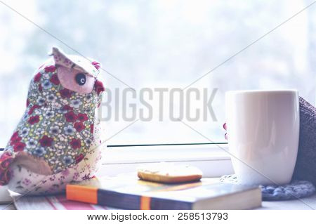 Winter Morning, With A Cup Of Coffee By The Window. Winter, Morning. A Cup Of Coffee And A Soft Toy