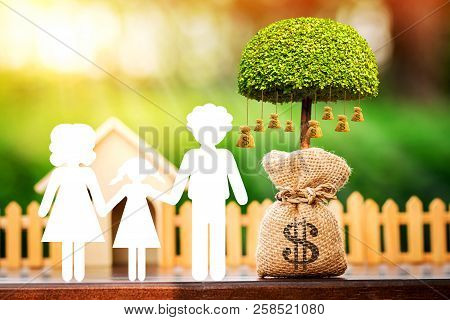 Family With Paper Cut And Money Bags Of Tree With Growing And Home In The Public Park, Saving Money