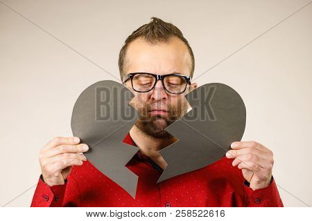 Depression, Sadness, Relationship Problem Concept. Man With Broken Heart Full Of Negative Sad Emotio