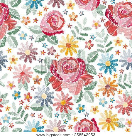 Embroidery Seamless Pattern With Beautiful Colorful Flowers On White Background. Fancywork In Vintag