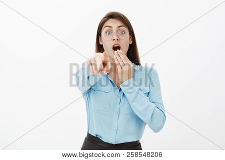Look There, It Is Unbelievable. Shocked Excited Funny Woman In Glasses And Blue Blouse, Covering Ope