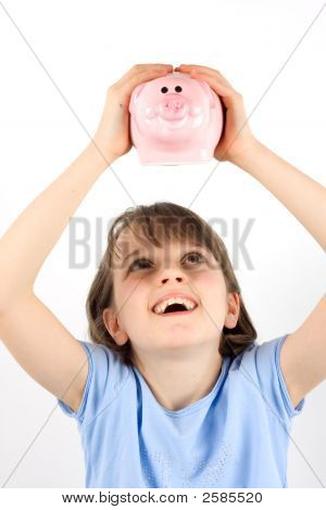 Girl Shaking A Piggy Bank