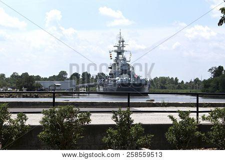 View Of Uss North Carolina From Riverwalk In Wilmington