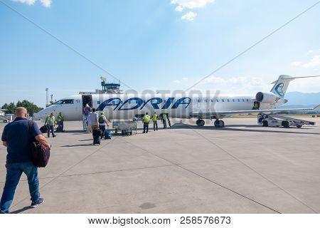 Skopje, Macedonia - August 25 2018: Passengers Board Adria Airways Bombardier Crj-900 Passenger Jet
