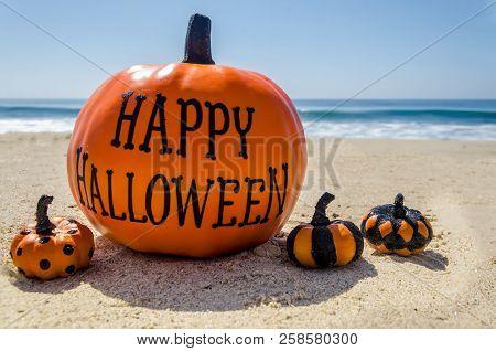Beach And Ocean Happy Halloween Background With Pumpkin