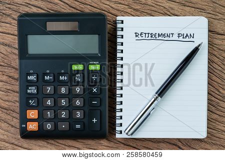 Retirement Planning Concept, Calculator With Empty Notepad With Pen And Handwriting Underline Headli