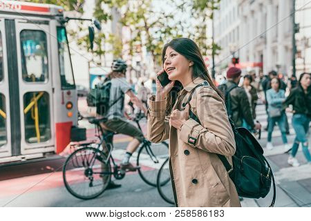 Woman Talking In Phone In Busy Working Day