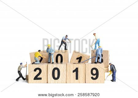 Miniature Worker Team Building Number 2019 On White Background