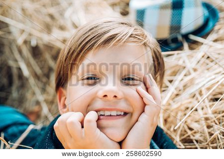 Autumn Happy Chid And Joy Boy On A Breeze In An Autumn Village. Autumn Sale For Kids Black Friday. H