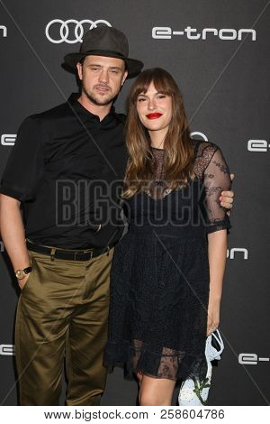 LOS ANGELES - SEP 13:  Boyd Holbrook, Tatiana Pajkovic at the Audi Pre-Emmy Party at the La Peer Hotel on September 13, 2018 in West Hollywood, CA