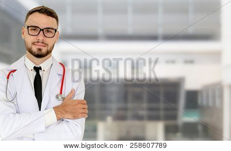 Young Male Doctor Working At The Hospital.