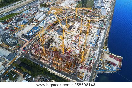 Aerial View Of A Construction Crane Tower. Top View Crane And Building Working Progress. Worker. Con