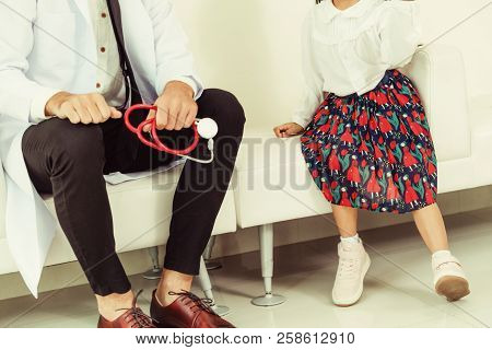 Happy Little Kid Visit Doctor In Hospital Office.