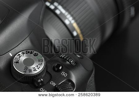 Close Up Of Modern Dslr Camera With Lens