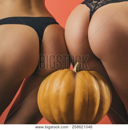 Pumpkins With Sexy Ass. Female With Sexy Ass Posing. Copy Space For Text. Halloween Poster With Sexy