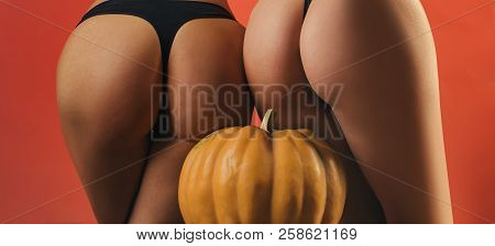 Pumpkin With Sexy Ass. Halloween Sexy Concept. Female With Sexy Ass Posing. Copy Space For Text. Hal