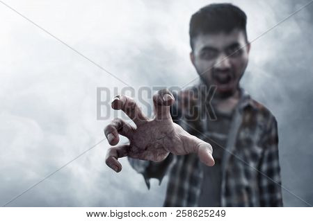 Scary Zombie Bloody Hand On Smoke Background