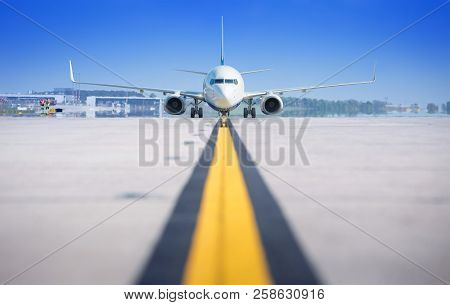 Modern Airliner On A Runway Against A Blue Sky