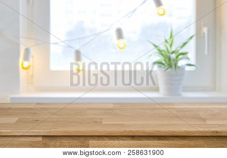 Wooden Empty Board In Front Of Blurred Holiday Window Background