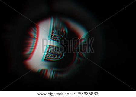 Bitcoin Under Loupe, You Can See Details Of The Surface Structure. Checking If The Coin Is A Fake Or