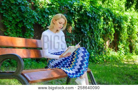Woman Blonde Take Break Relaxing In Park Reading Book. Reading Literature As Hobby. Books Are Her Pa