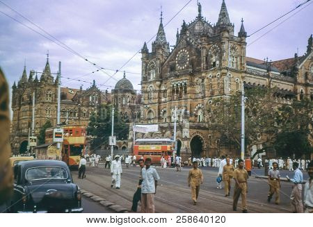 Bombay, India - Circa 1962: Vintage Photo Of Busy Street In Front Of Victoria Terminus Railway Build
