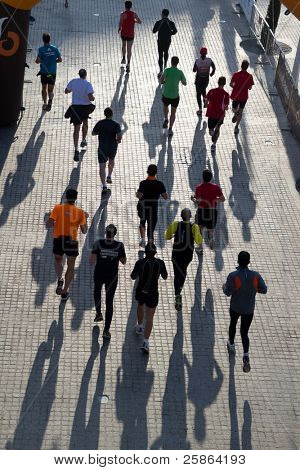 VALENCIA, SPAIN - NOV 27: Runners compete in the 31st Divina Pastora Valencia Marathon on November 27, 2011 in Valencia, Spain.