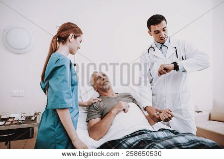 Help Doctor. Rehabilitation Patient. Body Patient. People In White Room. Rehab Patient. Old Man And