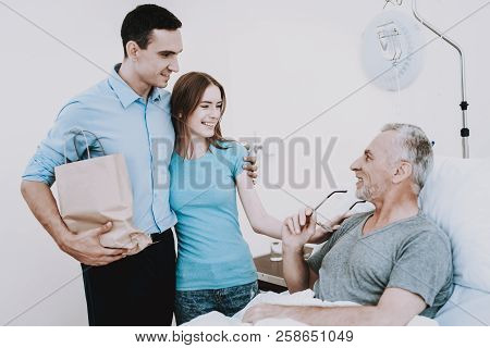 Happy People And Happy Patient. Aged Man And People In Hospital. Physical Man In Clinic. All People