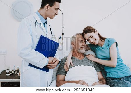 Medic In Hospital With Patient And Girl. People Happy In Clinic. Rehabilitation In Clinic For Patien