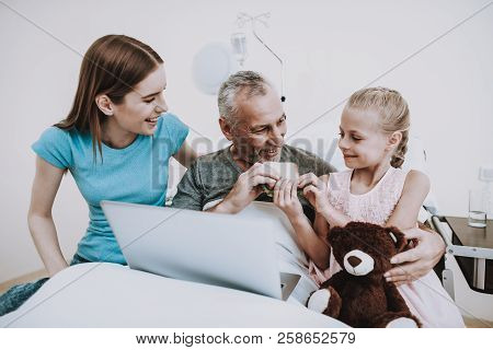 People In White Room With Old Man. Professional Family With Aged. Diagnosis With Laptop. Old Man And