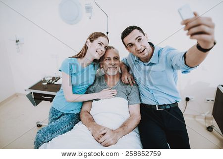 Selfie With Happy Family In Clinic. Young Man Selfie In Hospital. Young Girl Selfie In Clinic. Happy